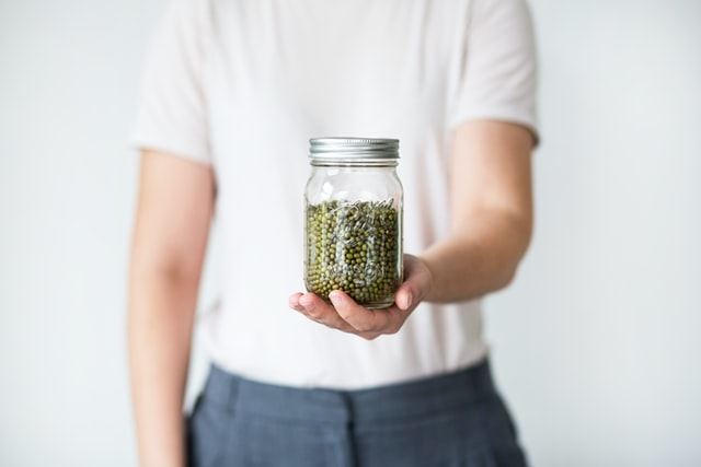 Photo by Laura Mitulla on Unsplash zero waste glass jar white shirt